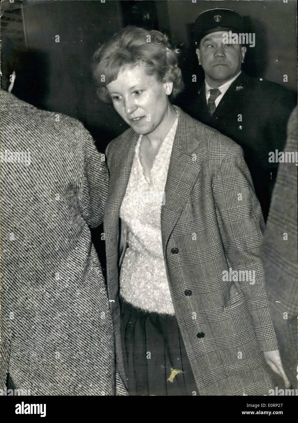 Apr. 04, 1960 - ''Ballets Rose'' Trial opens in Paris: Twenty three prominent people involved in one of the biggest post-war scandals (known as ''Ballets Rose'') were on trial at the Paris Correctional Court to-day. Photo shows MME Sorlut, wife of Pierre Sorlut, charged with promoting the Eballet Rose parties, pictured in the lobby of the Paris Law Courts. - Stock Image