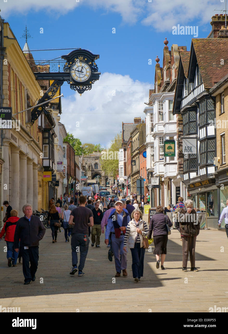 High Street in Winchester, Hampshire, England, UK - with town clock - Stock Image