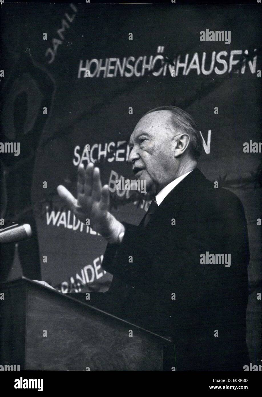 Feb. 15, 1960 - 10 years Association of Victims of Stalinism: The Association of Victims of Stalinism celebrates its 10th anniversary on Feb. 13th in Konigswinter (on Rhine). Most prominent guest at the celebration was Federal Chancellor Dr. Adenauer. The association is an organisation of former political prisoners of the Soviet system. Photo shows Dr. Adenauer during his speech at the celebration. In background a map crossed with barbed wire, indicating the places of sorrow for the victims of Stalinism. - Stock Image