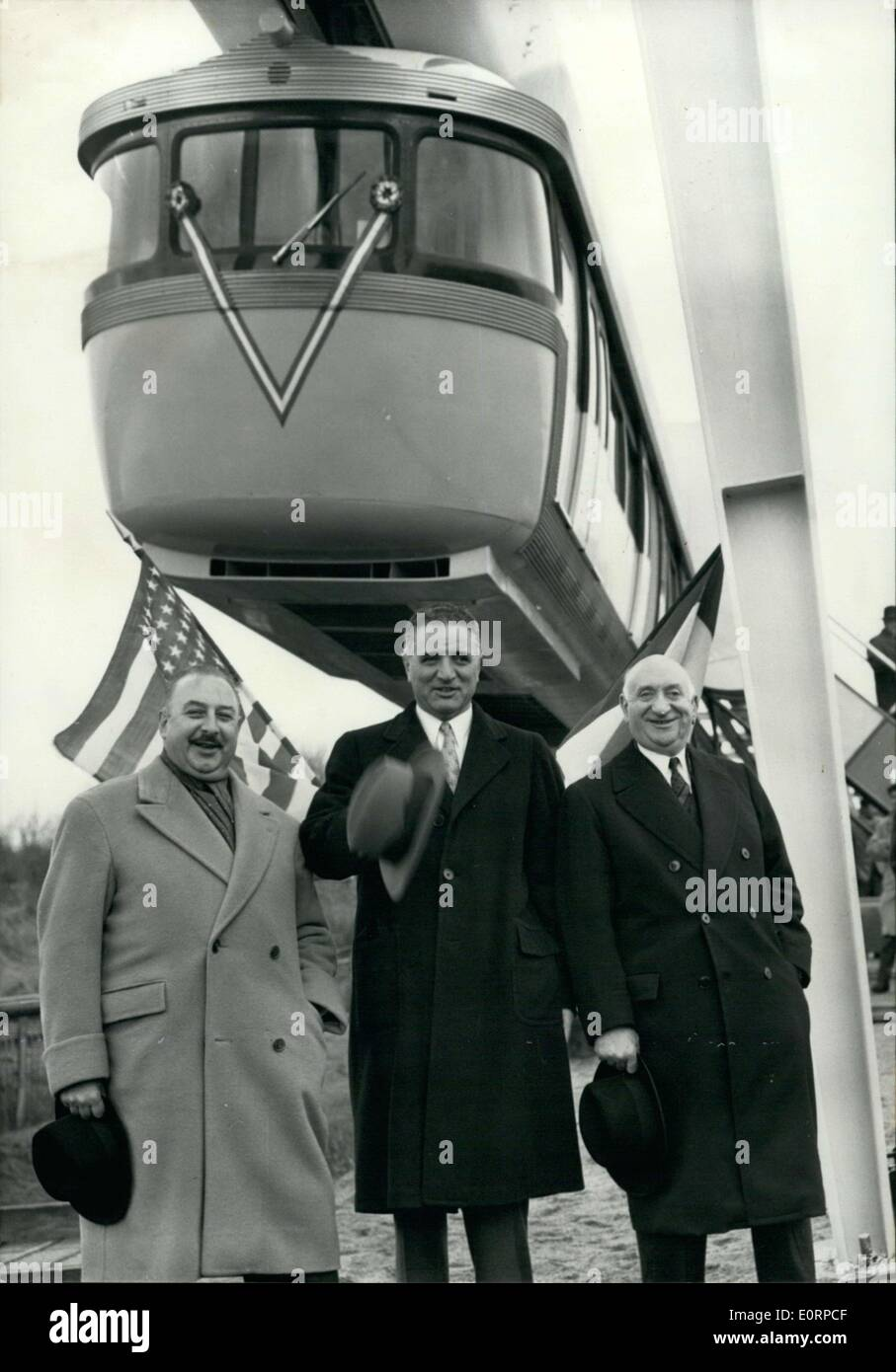 Feb. 23, 1960 - Georges Christopher, Mayor of San Francisco attended the presentation of the first French air-rail metro. This revolutionary metro conception will be presented in all the world's major cities in the following months. The 18 French businesses that built the train hope to sell it to San Francisco. Gaston Devraigne, President of Paris's Municipal Council, Mr. George Christopher, mayor of San Francisco, and Mr. Massoni are pictured standing in front of the plan from left to right. - Stock Image