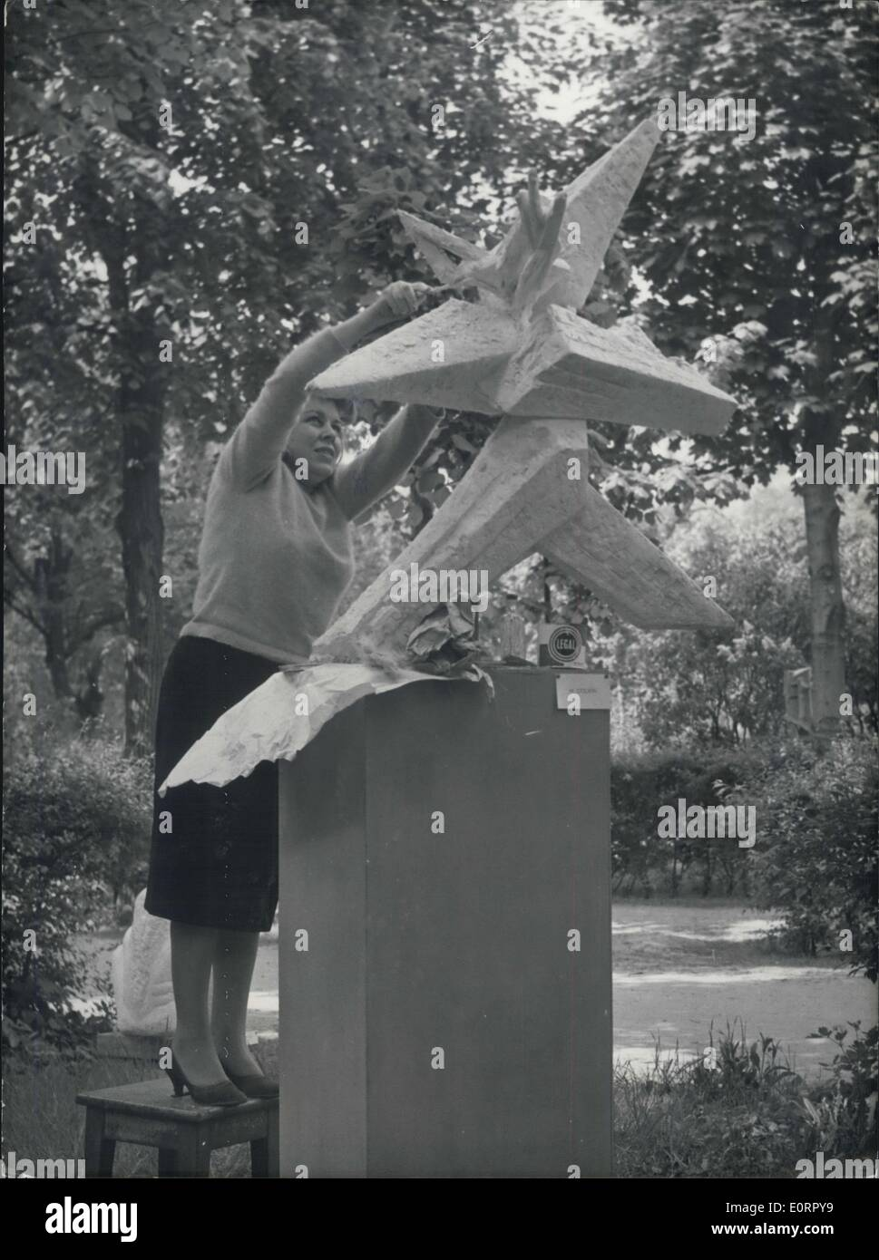 May 04, 1960 - Exhibition of ''Young Sculpture'' Opens in Paris: The Annual Exhibition of ''Young Sculpture'' Opened at the Muusee Rodin, Paris, today. Photo shows One of the Young Artists, ME Colvin Putting Some Finishing touches to her sculptures entitled ''The Southern Cross' - Stock Image