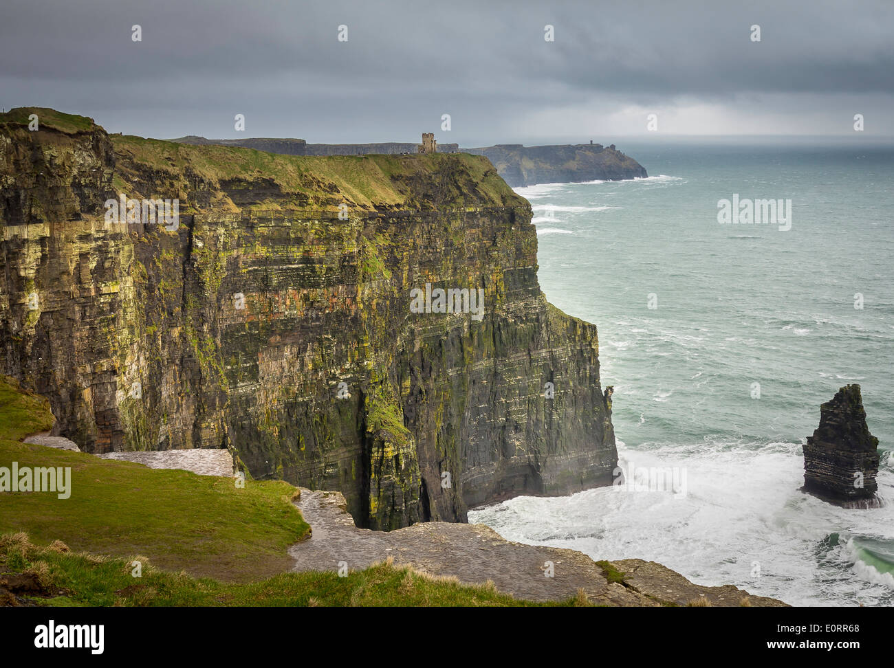 Cliffs of Moher on the Atlantic Coast of County Clare, Republic of Ireland, Europe with O'Brien's Tower on stormy day - Stock Image