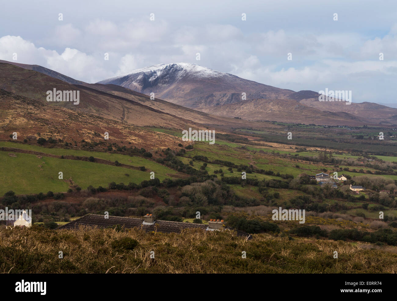 Ireland landscape in County Kerry near Dingle in the Republic of Ireland, with snow on the mountains in the distance Stock Photo