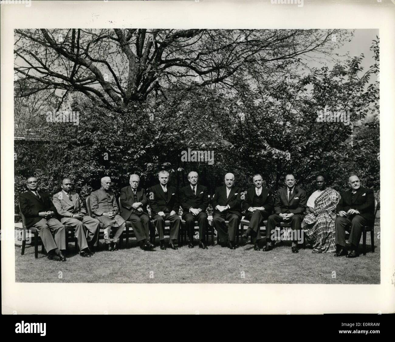 May 05, 1960 - Leaders of eleven nations: In the springtime garden of No. 10 Downing street, London, official residence of Britain's Prime Minister, leaders of eleven nations attending the ninth Commonwealth Prime Ministers' Conference pose for an official photograph. Left to right: Tunku Abdul Rahman, Prime Minister of the Federation of Malaya; Mr. Edmund Cooray, Minister of Justice for Ceylon; Shri Jawaharlal Nehru, Prime Minister of India; Mr. Walter Nash, Prime Minister of Canada; Mr - Stock Image