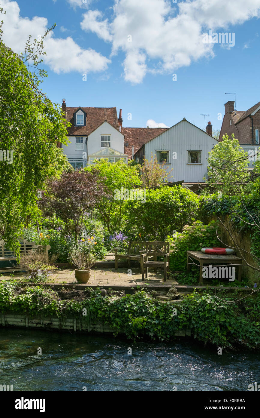 English garden - Riverside garden with pretty little waterfront patio in the South of England, UK in spring - Stock Image