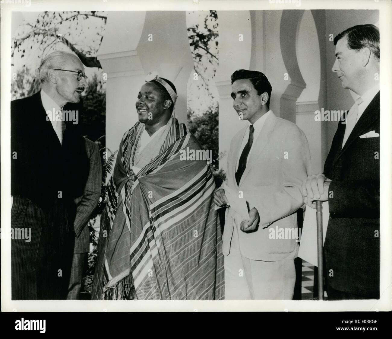 May 05, 1960 - Inter-racial Government: Five elected members, three African, one Asian and one European, were among 12 new Ministers sworn into the Council of Ministers of Tanganyika. The ceremony at Government House, Dar es Salaam, marked a significant step forward in the African territory's progress towards self-Government with British co-operation. The Governor, Sir Richard Turnbull, said it was the end of wholly official Government and the beginning of Government in which elected members share in the formation of Government policies - Stock Image