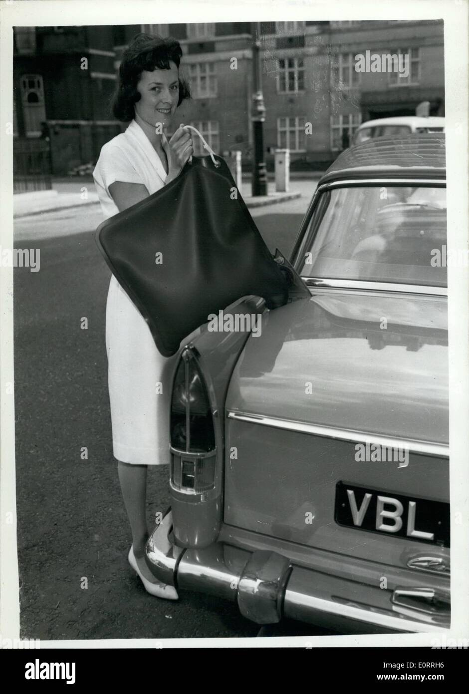 May 05, 1960 - New uses for nylon container for Petrol; Yvonne Mintrans of Fawley, Hants demonstrates a new liquid container - which holds four gallons of Petrol. This is one of the many new items made of Nylon demonstrated at the British Nylon Spinners Exhibition in Park Lane today. - Stock Image