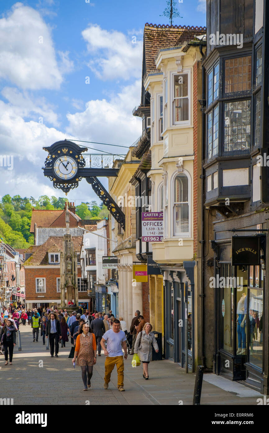 Winchester, Hampshire, England, UK - the High Street with town clock - Stock Image