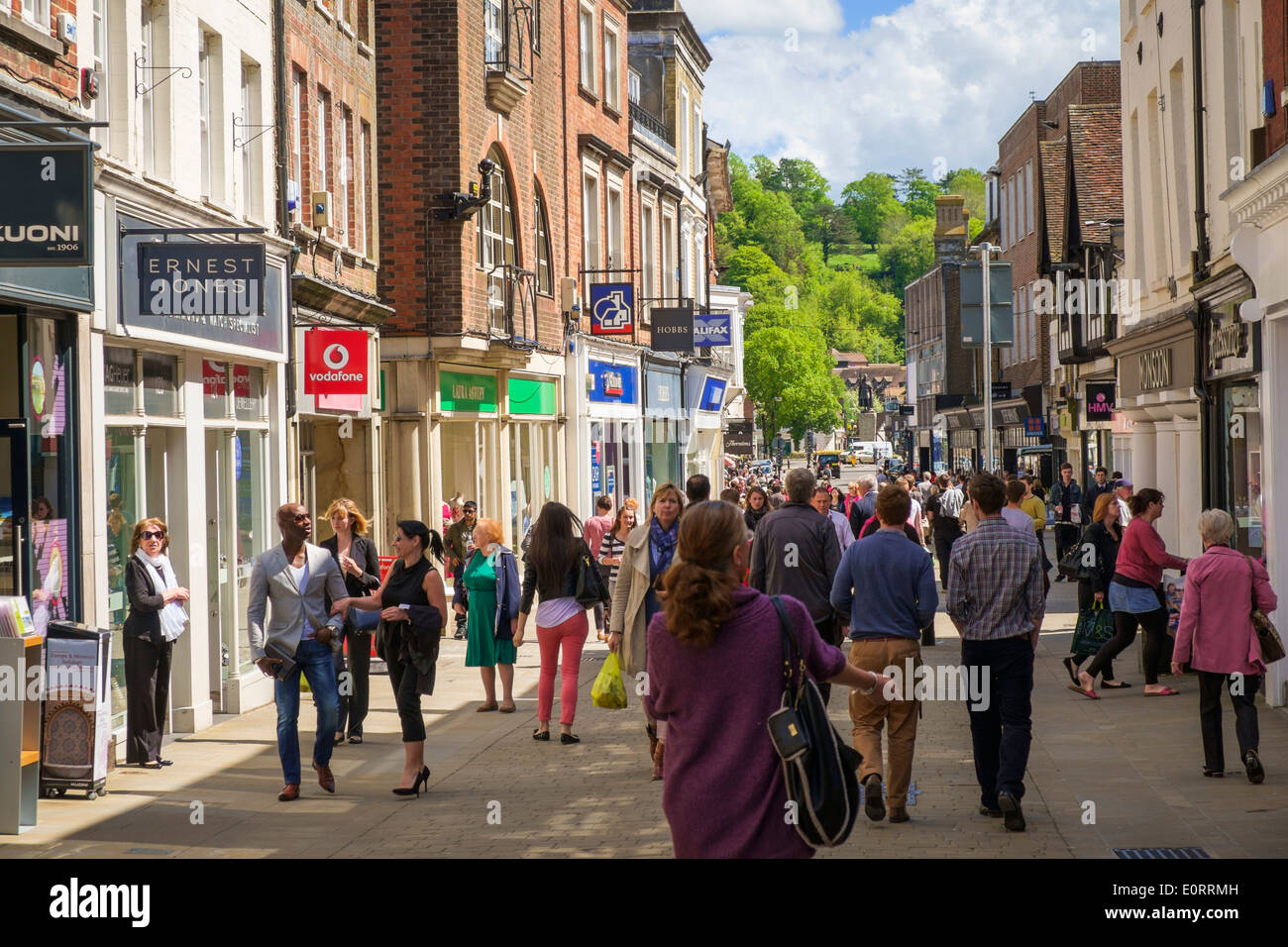 Busy shopping street UK, with shops in Winchester, Hampshire - Stock Image