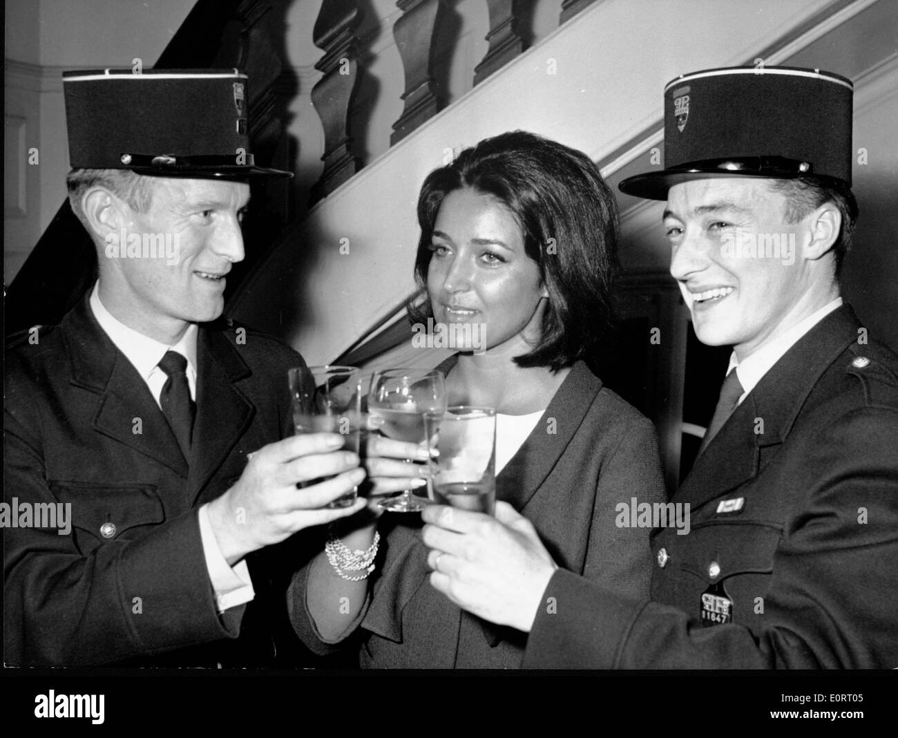 Actress Francoise Fabian toasts police - Stock Image