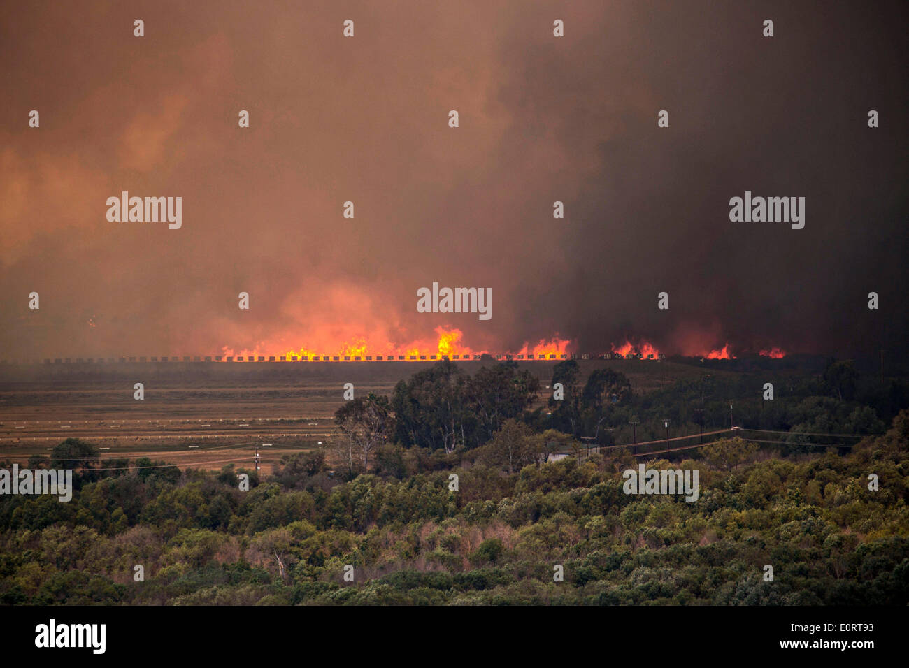 The Las Pulgas wildfire burns through the rifle range in the foothills around the Marine Corps Air Station May 16, 2014 in Camp Pendleton, California. - Stock Image