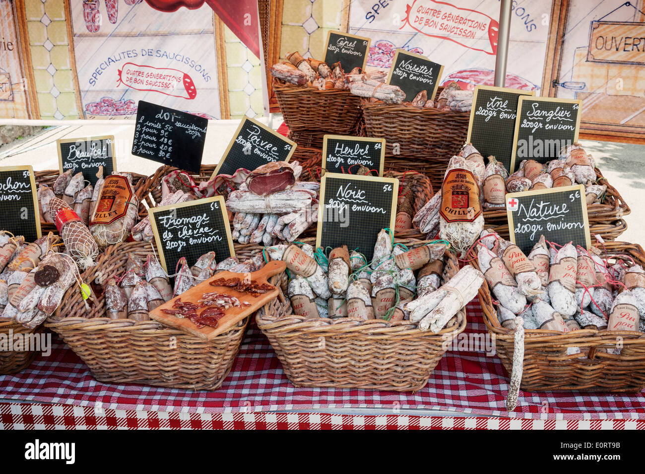 Salami sausage meat display on a market stall, Brittany, France, Europe - Stock Image