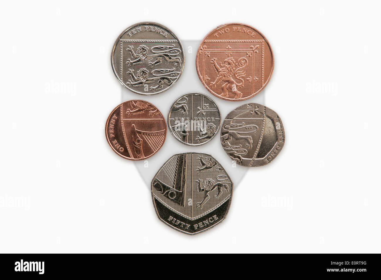 Reverse side of British sterling coins which form the Queen's coat of arms shield - Stock Image