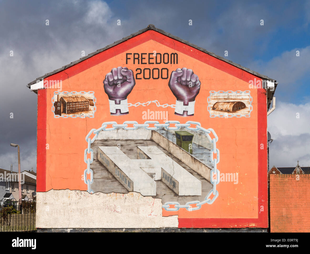 Mural wall painting of notorious H Block prison on side of house in Belfast, Northern Ireland - Stock Image