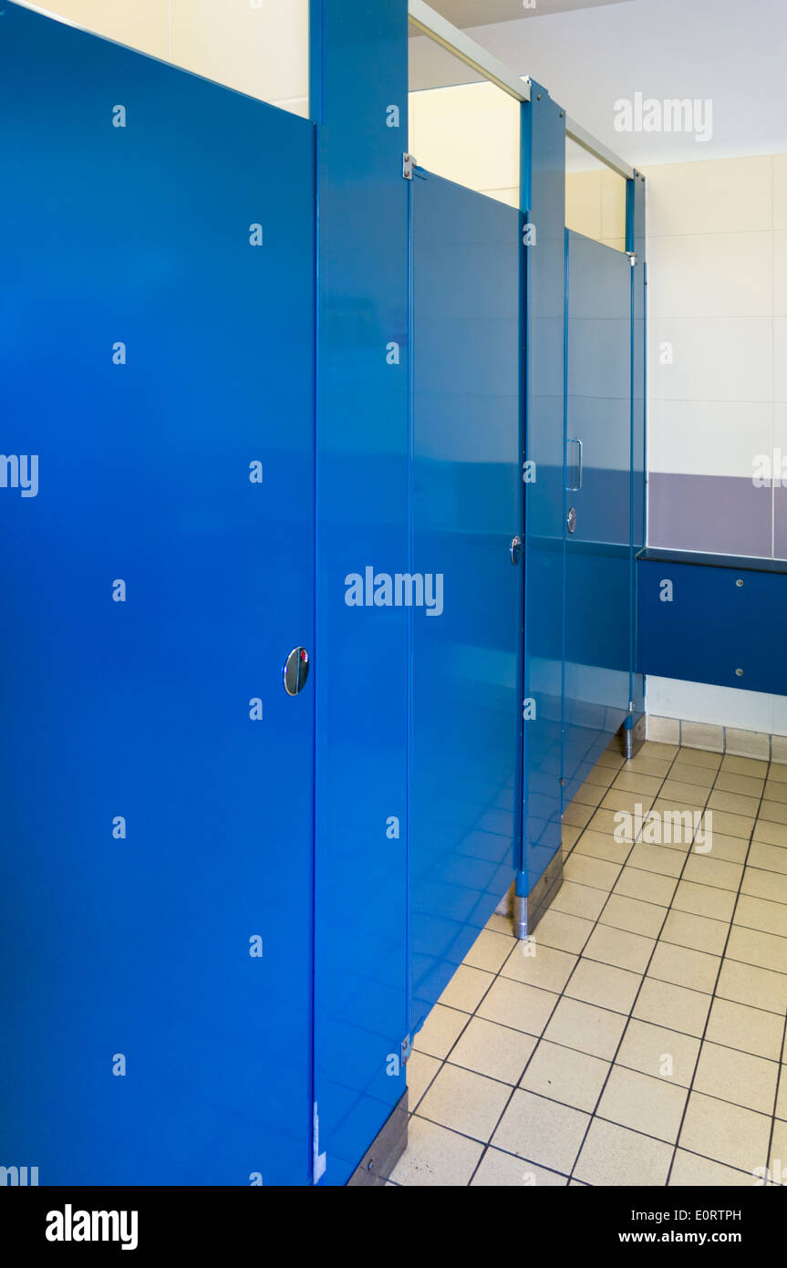 Row of public toilet cubicles - Stock Image