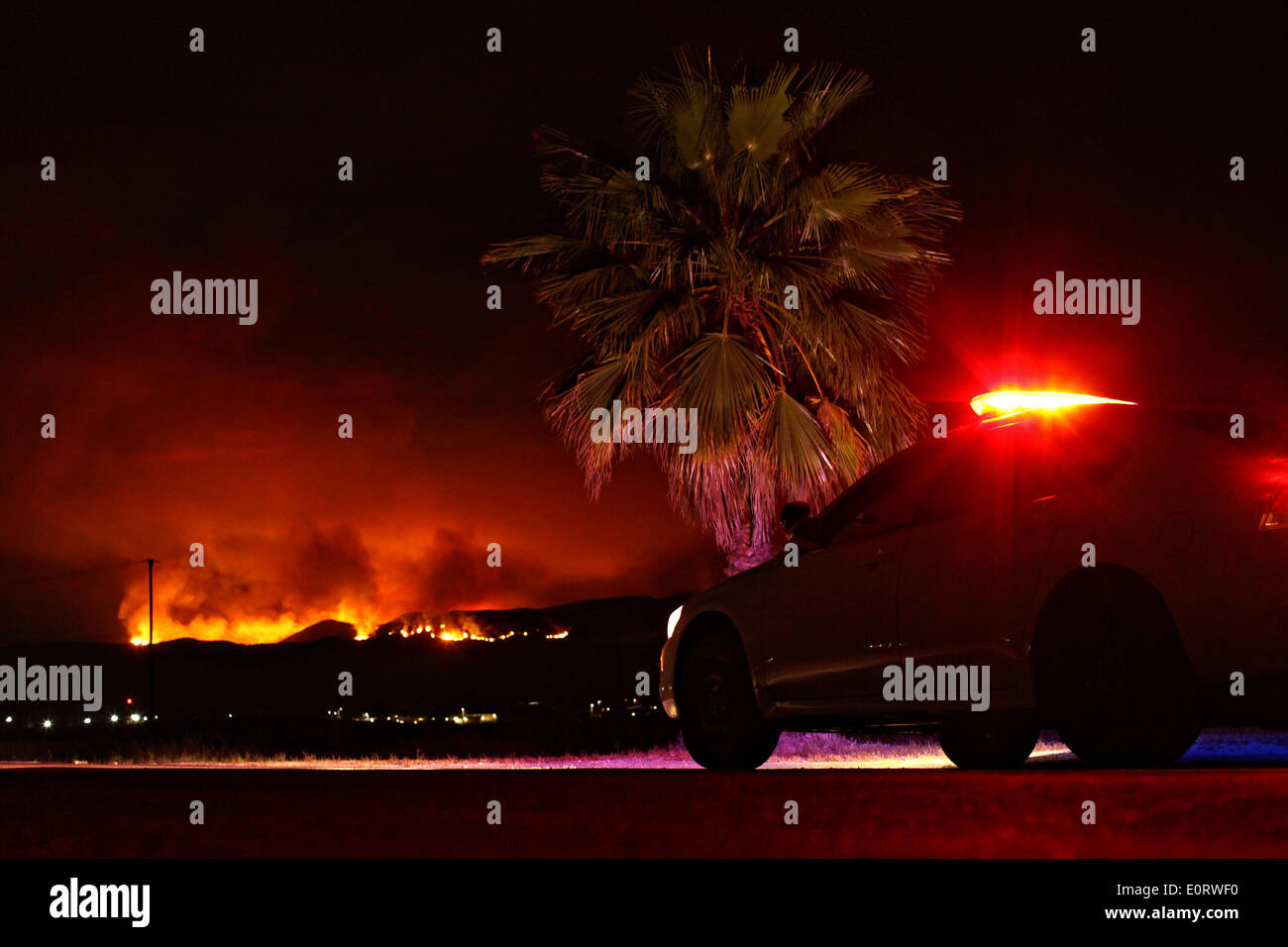 The Las Pulgas and Tomahawk wildfire burns at night in the foothills around the Marine Corps Air Station May 15, 2014 in Camp Pendleton, California. - Stock Image