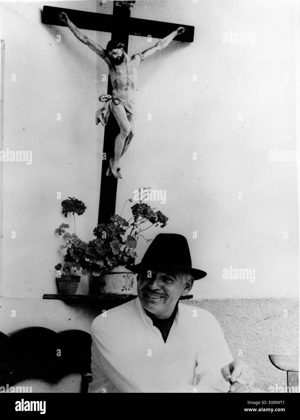 Actor Clark Gable enjoys a cigarette - Stock Image