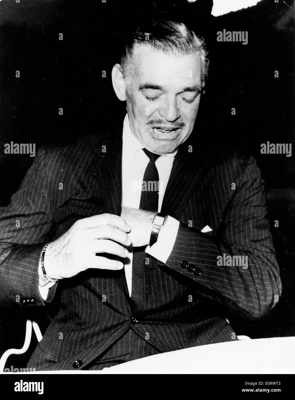 Actor Clark Gable adjusts his watch - Stock Image