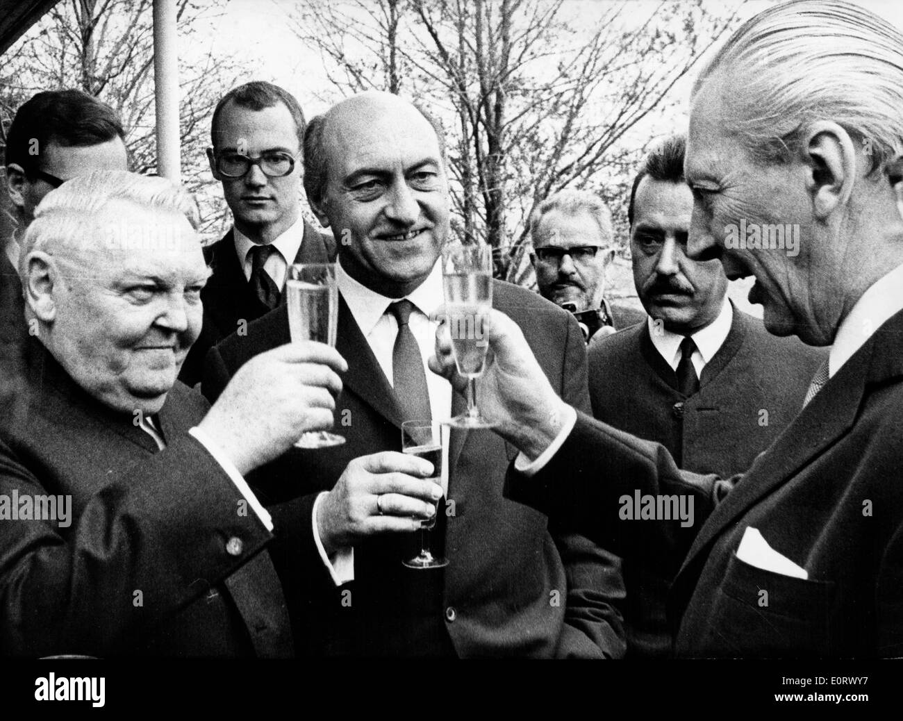 Ludwig Erhard toasting with others - Stock Image