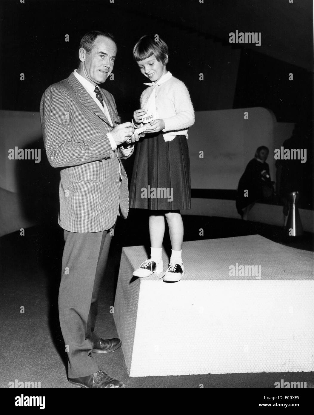 Actor Henry Fonda signs autograph for little girl - Stock Image