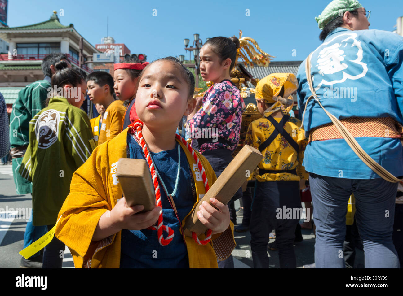 Young girl in a happi with hyoshigi at Sanja Matsuri at Sensō-ji (Asakusa Kannon Temple), Tokyo, Japan. - Stock Image