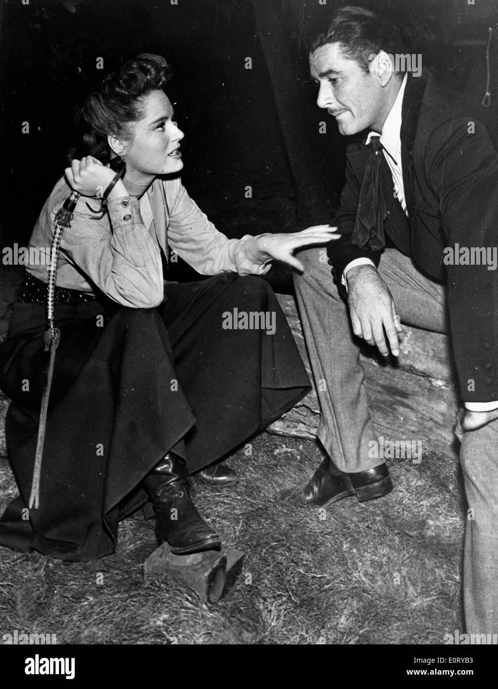 Actor Errol Flynn and co-star in film scene - Stock Image