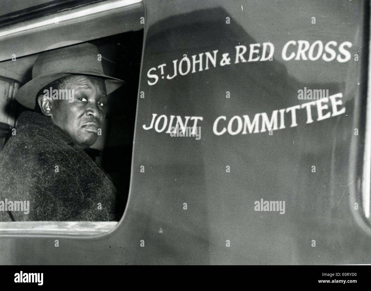 TSEKEDI KHAMA, regent of the Bamangwato tribe sits in a St. John and Red Cross Joint Committee vehicle. - Stock Image