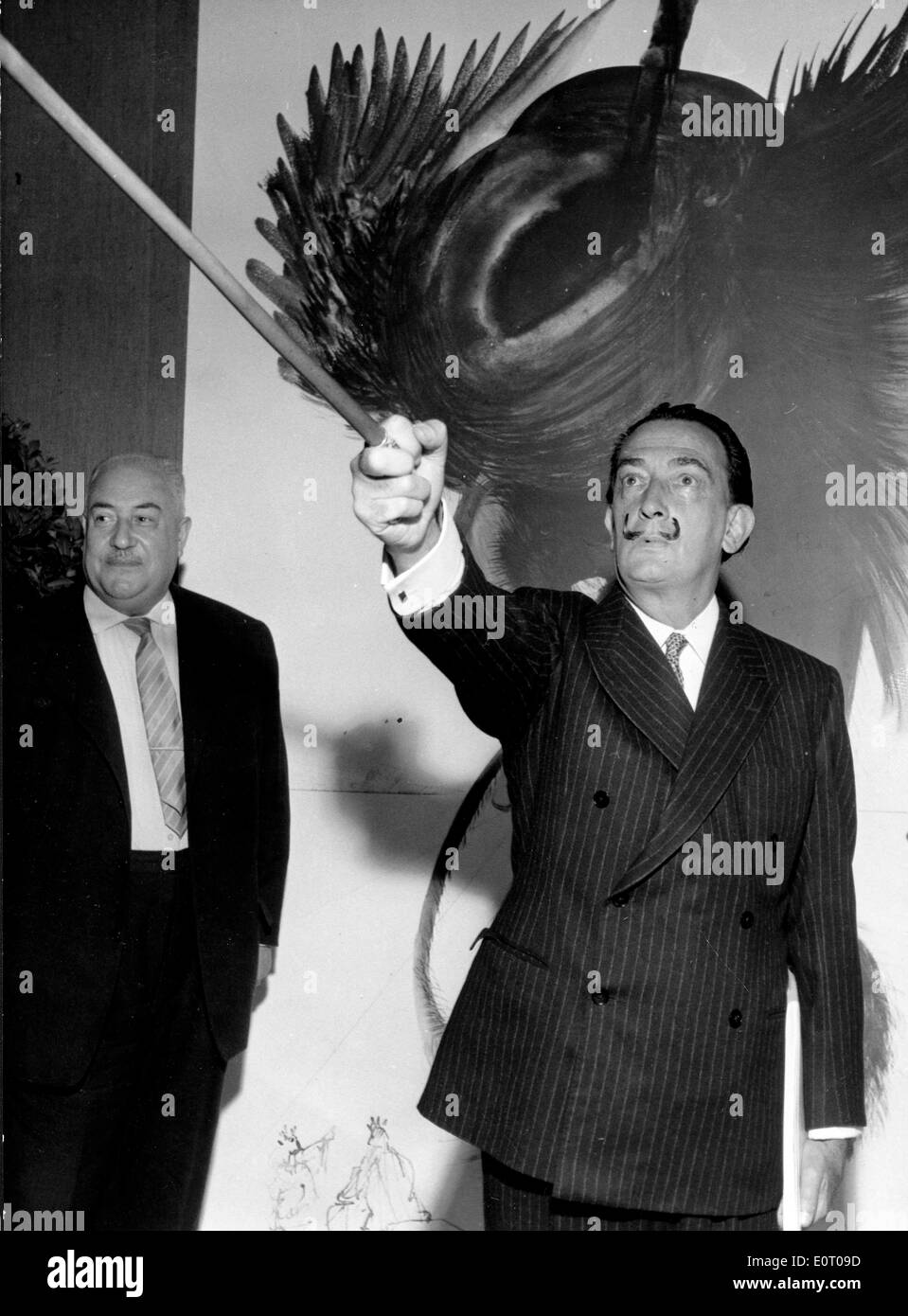 Salvador Dali in front of his painting 'Satan' - Stock Image