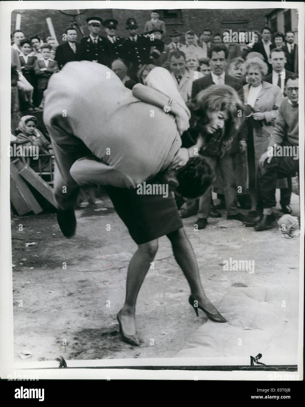 Jun. 06, 1960 - Sophia Loren And Peter Sellers Film Location Shots For ''The Millionairess''.. Italian film star Sophia Loren British comedian Peter Sellers and Dennis Price were to be seen making location shots for their new film ''The Millionaires '' in Upper Thames Street, London yesterday. Photo shows Sophia Loren performs a Judo throw on Ray Austin (stand -in for Denis Price) during filming in London. - Stock Image