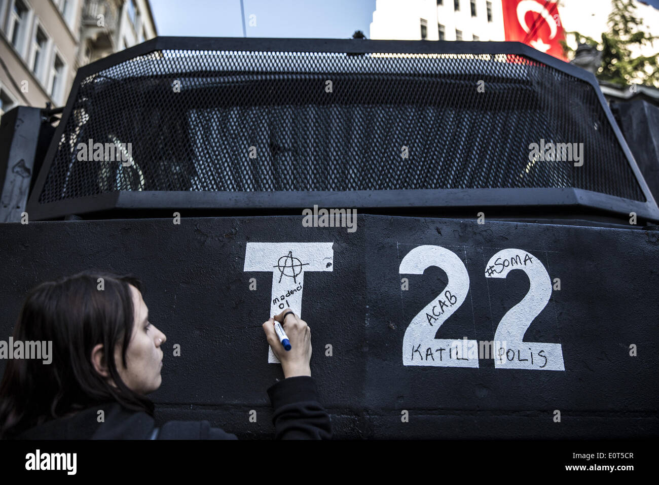 Istanbul, Turkey. 17th May, 2014. A protesters writes on a water canon truck ''Murderer! Be a miner and live with pride'' during a protest in Istanbul on May 17, 2014. Anger has been mounting across the country regarding the government's handling and responsibility in the Soma mine accident, the worst in Turkey's history, which killed at least 300 miners. PHOTO BY JODI HILTON/NURPHOTO © Jodi Hilton/NurPhoto/ZUMAPRESS.com/Alamy Live News - Stock Image