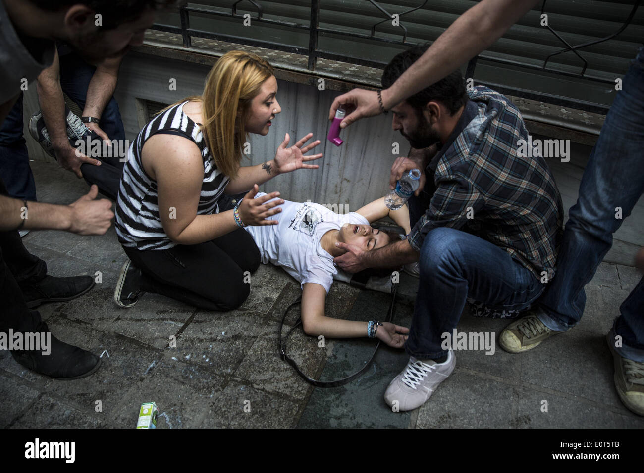 Istanbul, Turkey. 17th May, 2014. A girl fell ill and had difficulty breathing after police fired tear gas at protesters on May 17, 2014 in Istanbul. Anger has been mounting across the country regarding the government's handling and responsibility in the Soma mine accident, the worst in Turkey's history, which killed at least 300 miners. PHOTO BY JODI HILTON/NURPHOTO © Jodi Hilton/NurPhoto/ZUMAPRESS.com/Alamy Live News - Stock Image
