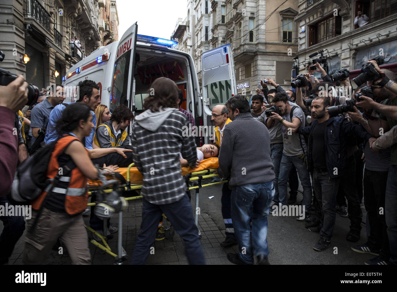 Istanbul, Turkey. 17th May, 2014. EMTs transfer a girl into an ambulance after she fell ill and had difficulty breathing after police fired tear gas at protesters in Istanbul on May 17, 2014. Anger has been mounting across the country regarding the government's handling and responsibility in the Soma mine accident, the worst in Turkey's history, which killed at least 300 miners. PHOTO BY JODI HILTON/NURPHOTO © Jodi Hilton/NurPhoto/ZUMAPRESS.com/Alamy Live News - Stock Image