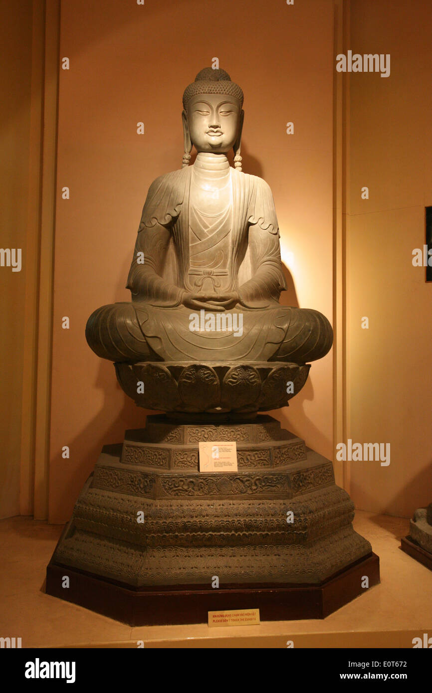 Ancient buddha statue in the National History Museum in Hanoi. - Stock Image