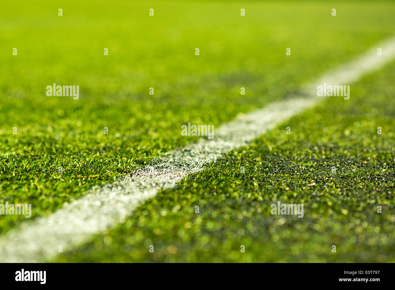 Close-up of artifical soccer pitch on a sunny day. - Stock Image