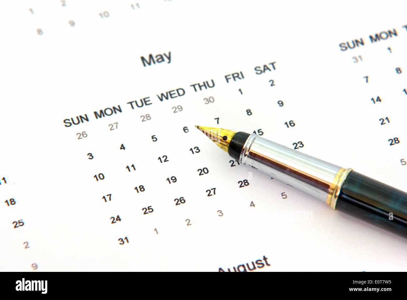 Close up of a calendar and a pen - Stock Image