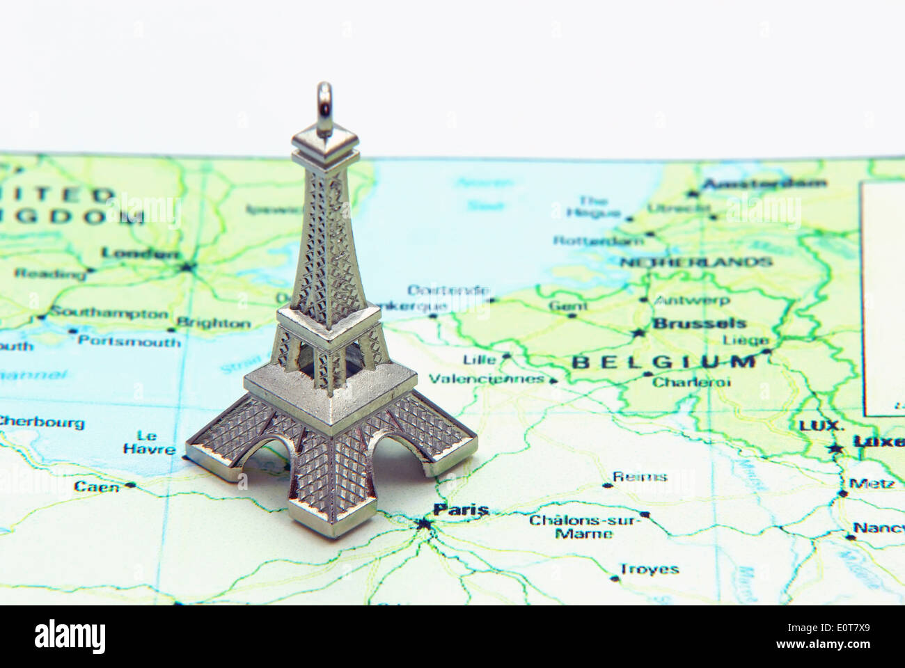 Statue of Eiffel Tower on a map of France Stock Photo