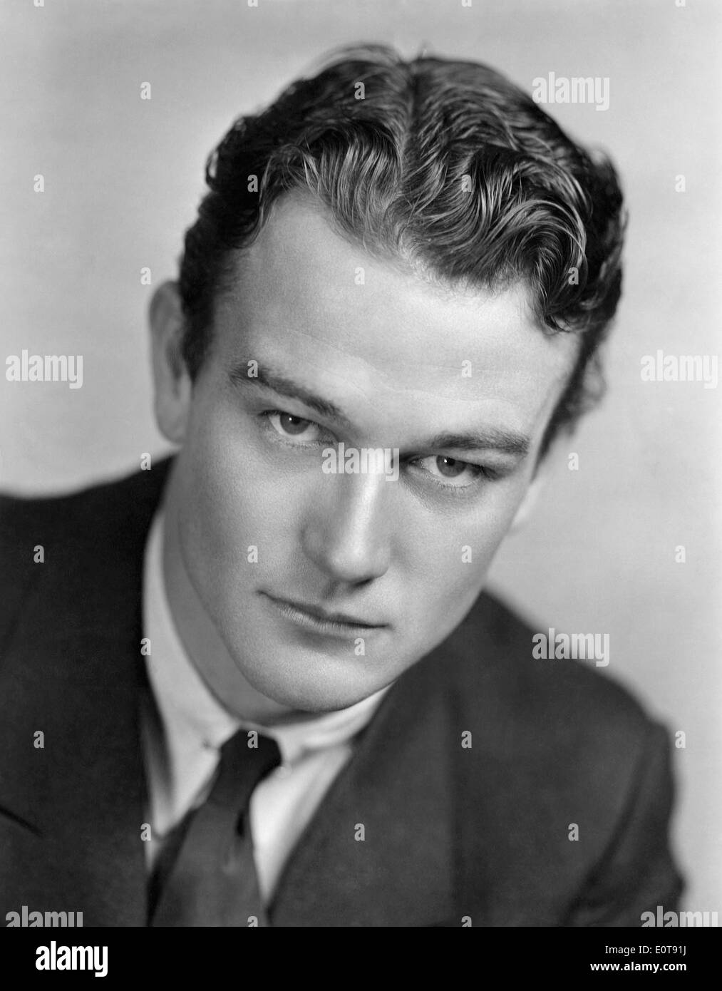 John Wayne, Portrait, on-set of the Film, 'Three Girls Lost', 1931 - Stock Image