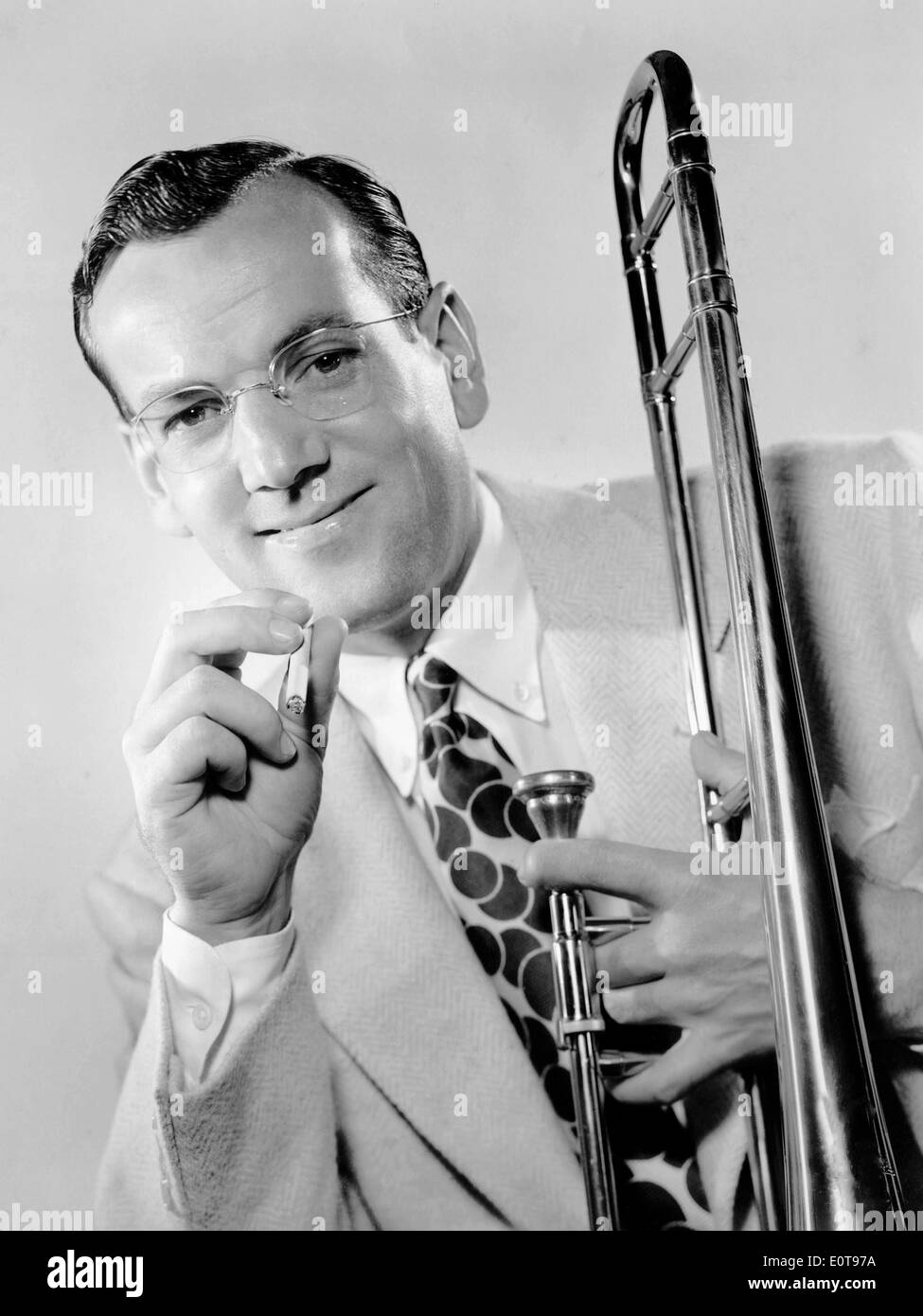 Glenn Miller, Portrait with Cigarette and Trombone, circa 1944 - Stock Image