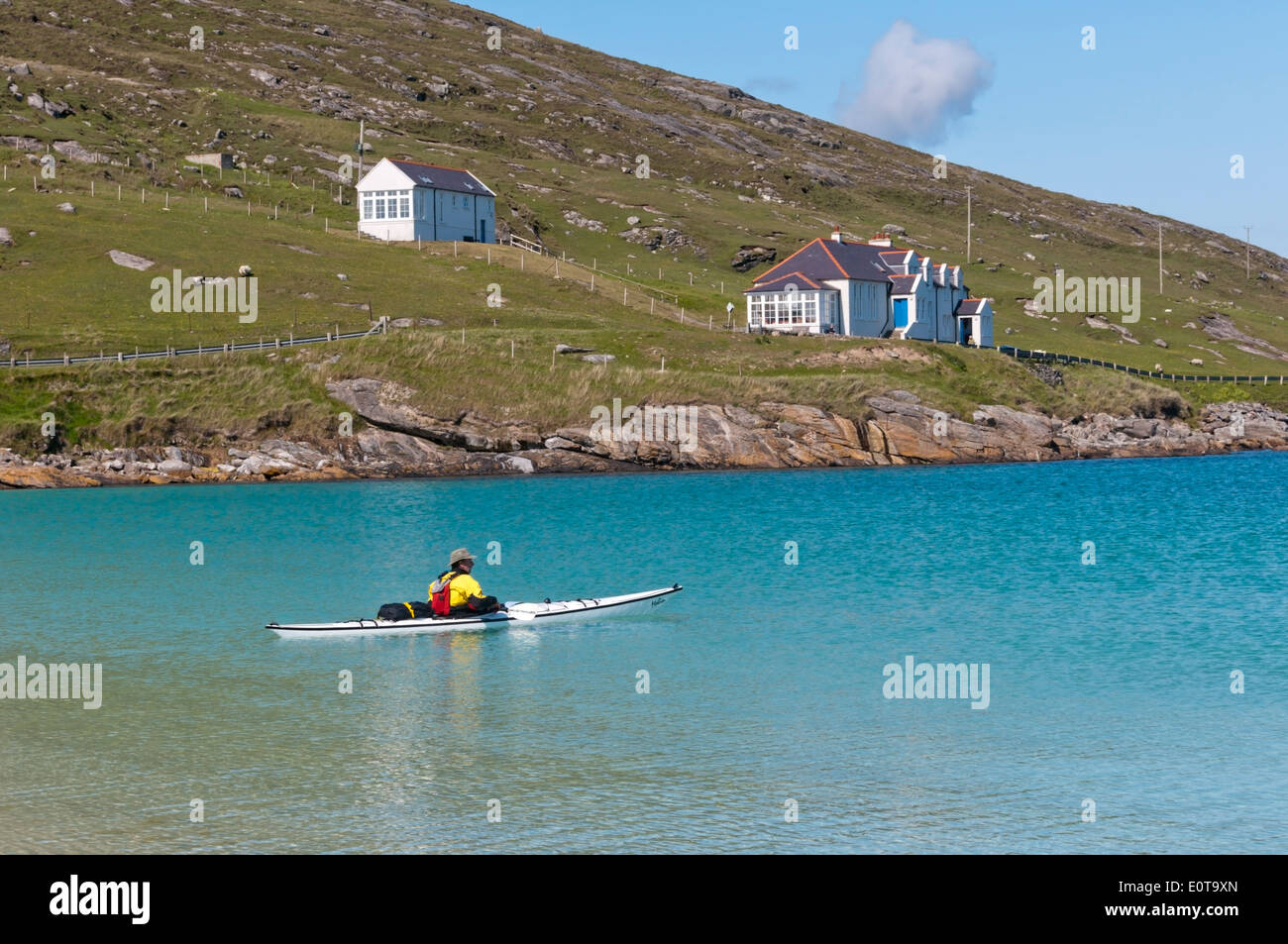 Kayaker paddling in the east bay of Vatersay in the Outer Hebrides. - Stock Image