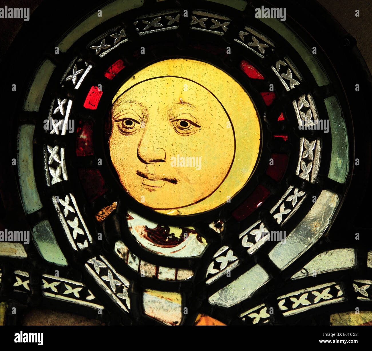 English Medieval stained glass window, Man in Moon, Burnham Deepdale, Norfolk England UK - Stock Image