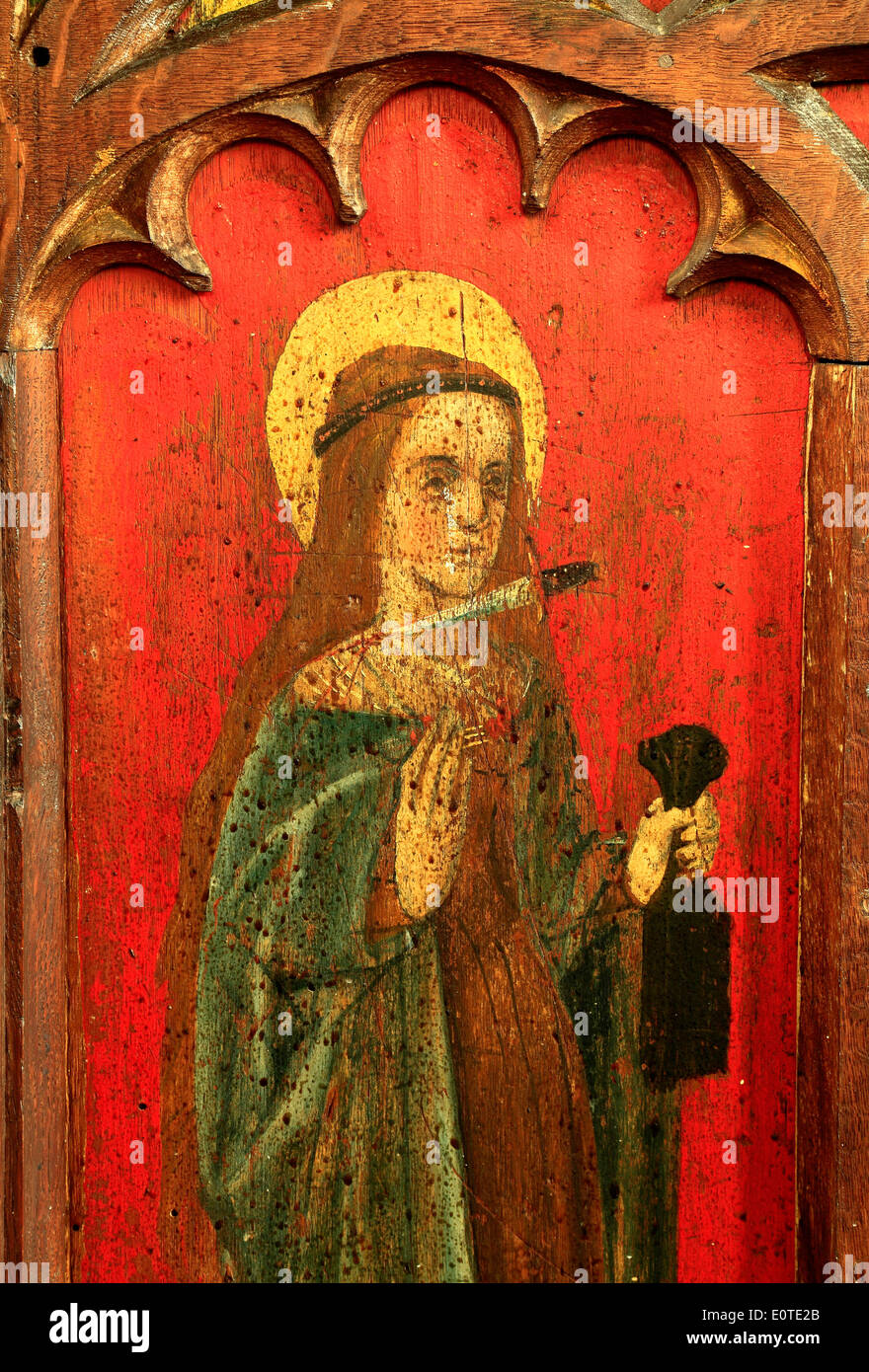 St. Agnes, English medieval rood screen painting, c.1500, North Tuddenham, Norfolk, with dagger at her throat, paintings art - Stock Image