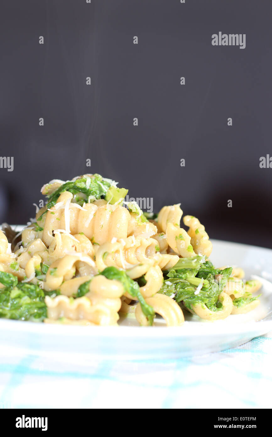 Whole grained shaped pasta with spinach. - Stock Image