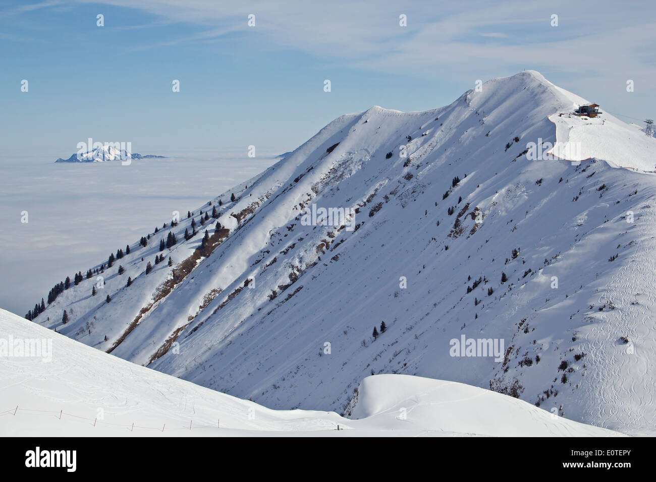 Winter landscape viewed from Kanzelwand, mountain in Austria. Mountain Grunten in clouds in the background. Stock Photo