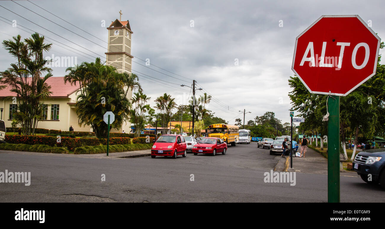 Church and street scene in the tourist town of La Fortuna in the shadow of Arenal volcano Costa Rica - Stock Image