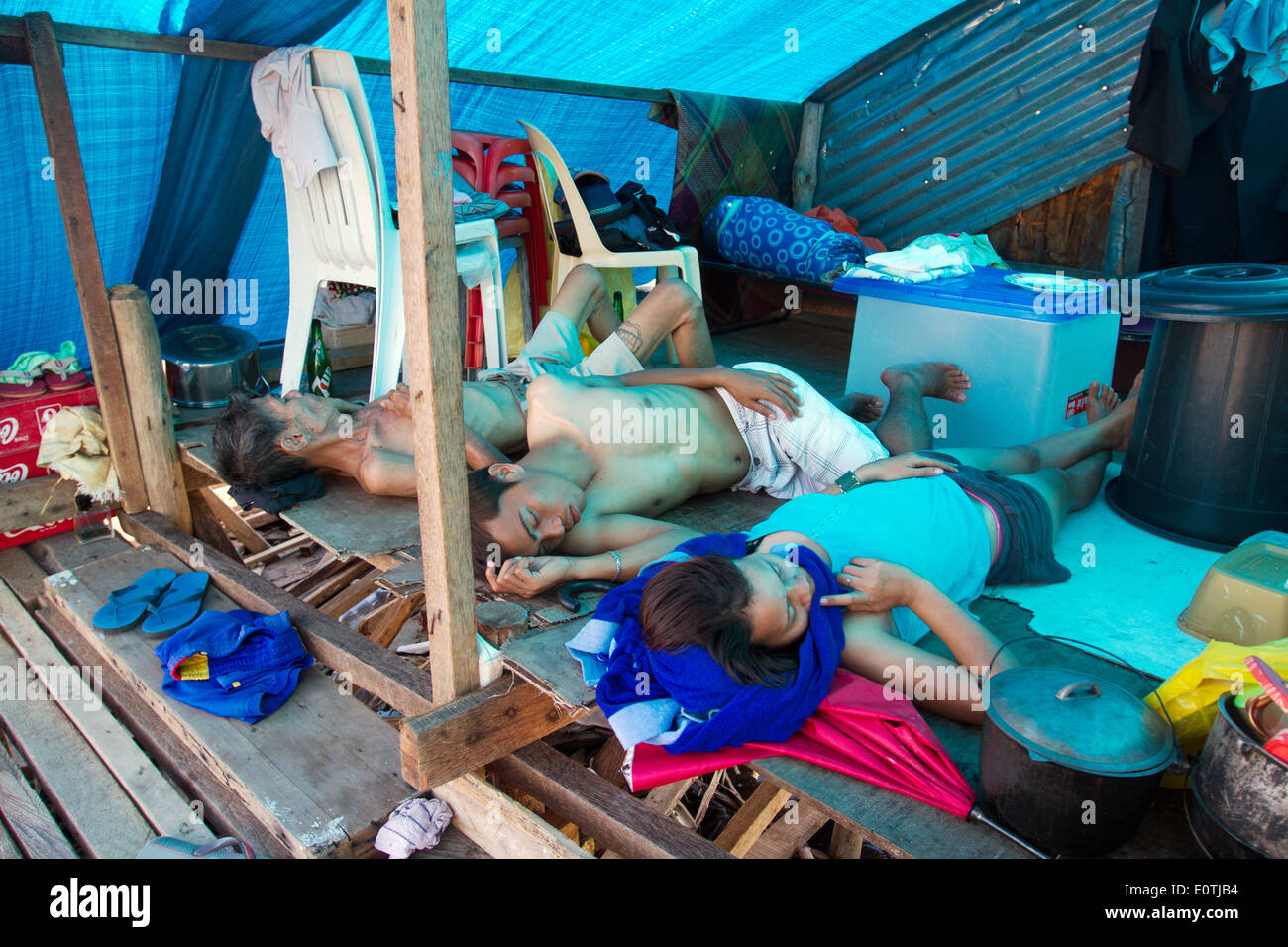 Survivors sleeping under a shelter Tacloban City Philippines - Stock Image