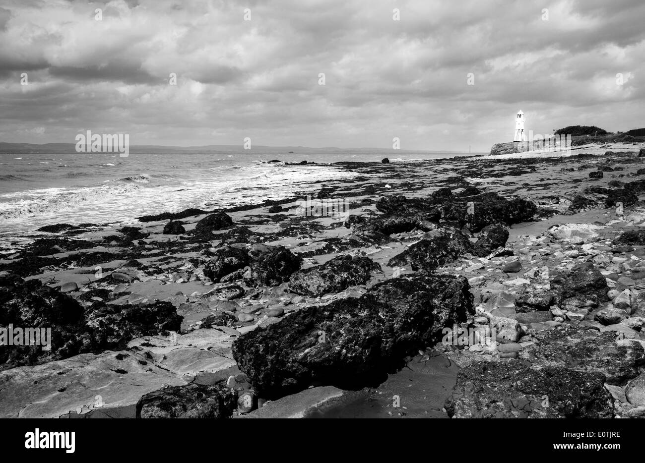 Black Nore point and lighthouse on the Somerset shore of the Severn Estuary UK - Stock Image
