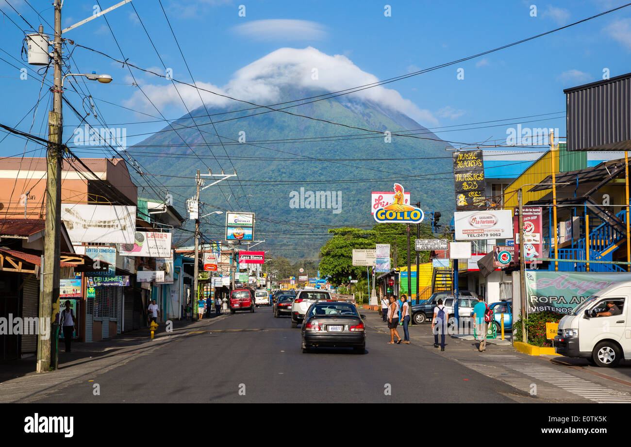Main street of La Fortuna in the shadow of Arenal volcano Costa Rica - Stock Image
