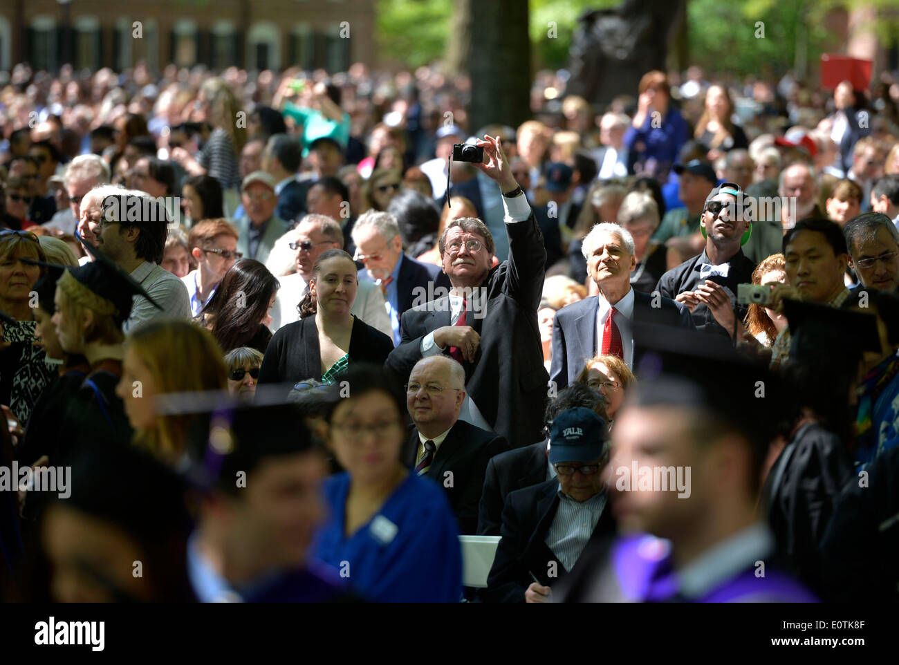 New Haven, USA. 19th May, 2014. Parents of Yale University students attend the 313th Commencement of Yale University at the Old Campus in New Haven, the United States, May 19, 2014. Twelve honorary doctorates and 3132 earned degrees were conferred on Monday during Yale's 313th Commencement ceremony, in addition to 253 provisional degrees for students who have yet to fully complete their study. Credit:  Wang Lei/Xinhua/Alamy Live News - Stock Image