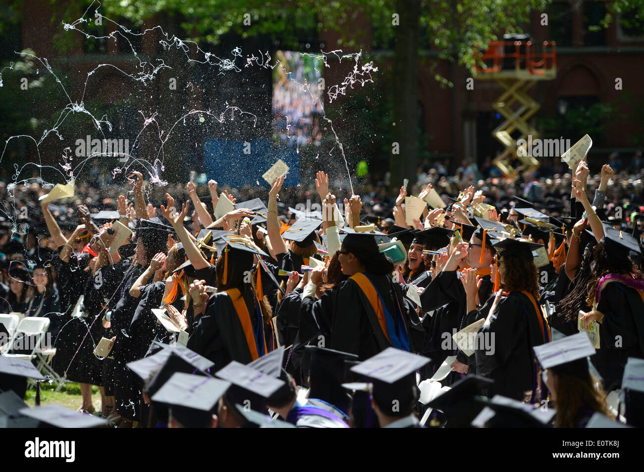 New Haven, USA. 19th May, 2014. Students of Yale University attend the 313th Commencement of Yale University at the Old Campus in New Haven, the United States, May 19, 2014. Twelve honorary doctorates and 3132 earned degrees were conferred on Monday during Yale's 313th Commencement ceremony, in addition to 253 provisional degrees for students who have yet to fully complete their study. Credit:  Wang Lei/Xinhua/Alamy Live News - Stock Image