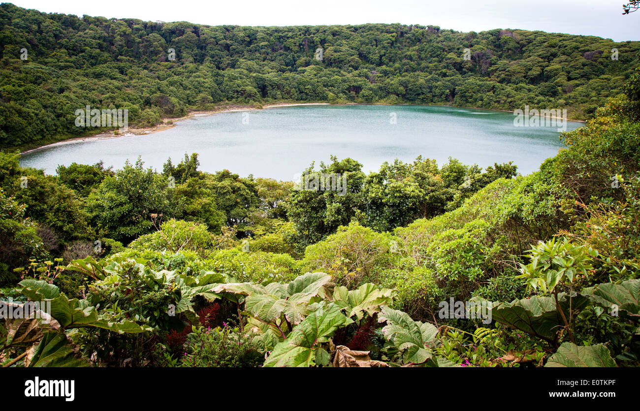 Lagos Botos is a forest fringed emerald lake that fills an extinct crater near the active Poas volcano in central Costa Rica Stock Photo
